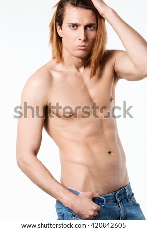 Beautiful muscular male model with nice abs in jeans isolated on white background. - stock photo