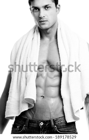 Beautiful muscular man with the towel. - stock photo
