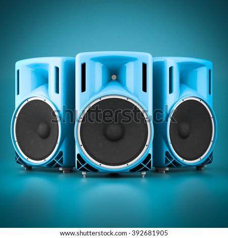 Beautiful music speaker isolated on blue background - stock photo