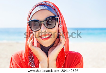 beautiful muslim caucasian woman wearing sunglasses - stock photo