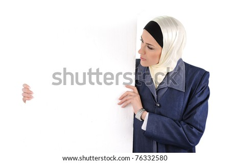Beautiful Muslim fashion girl holding an empty banner, copy-space - stock photo