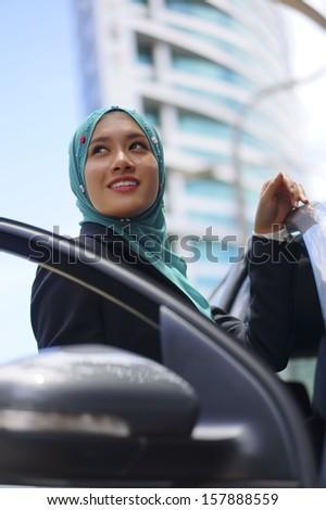 Beautiful Muslim girl with a car  - stock photo