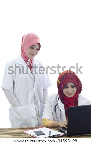 beautiful muslim medical doctors woman working with computer isolated on white background - stock photo