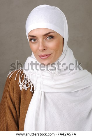 Beautiful Muslim positive woman smiling portrait - stock photo