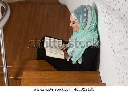 Beautiful Muslim Woman Wearing Hijab And Reading The Koran
