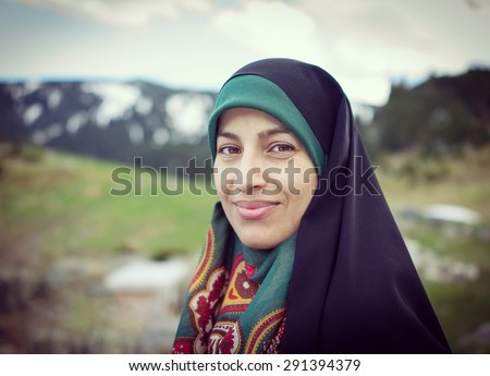 Beautiful Muslim woman with scarf - stock photo
