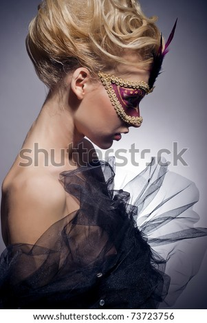 Beautiful mysterious girl in a Venetian mask - stock photo