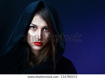 beautiful mysterious woman in black hood evil halloween witch look - stock photo