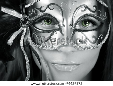 beautiful mysterious woman with green eyes - stock photo
