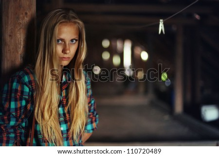 beautiful mysterious young woman in the attic in a wooden house with ghosts - stock photo