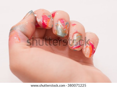 Beautiful nails and flower close-up, great idea for the advertising of cosmetics. Light manicure in light on a white background. - stock photo