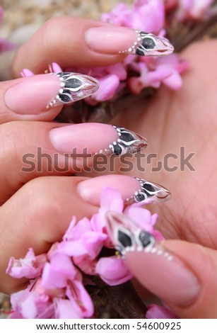 Beautiful nails with gorgeous manicure - stock photo