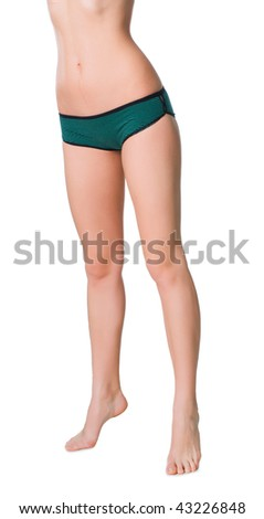 Beautiful naked female legs at white background