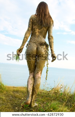 Beautiful naked girl in a loincloth totally wild - stock photo