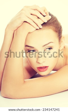 Beautiful naked topless caucasian woman lying down. Isolated on white. - stock photo