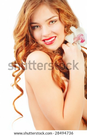 Beautiful naked woman with long curly hair on white - stock photo