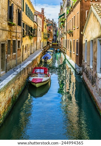 Beautiful narrow channel of old Venice - stock photo