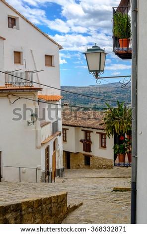 Beautiful narrow medieval street in Morella town, Valencia, Spain. - stock photo