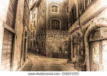 beautiful narrow street in Florence in sepia tone, Italy - stock photo