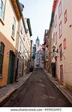 Beautiful narrow street of Rue Christie lined by ancient buildings in Old Quebec City, Quebec, Canada