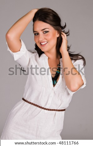 Beautiful Native American brunette in a white linen dress