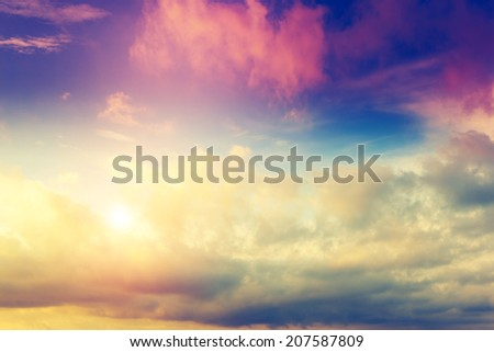Beautiful natural background. Fantastic colorful sunset and dark ominous clouds. Beauty world. - stock photo