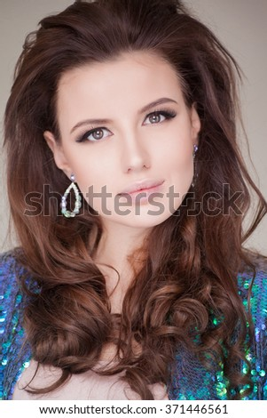 Beautiful natural curly brunette hair, portrait of an young girl isolated