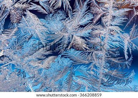 beautiful natural frosty pattern on winter window glass - stock photo