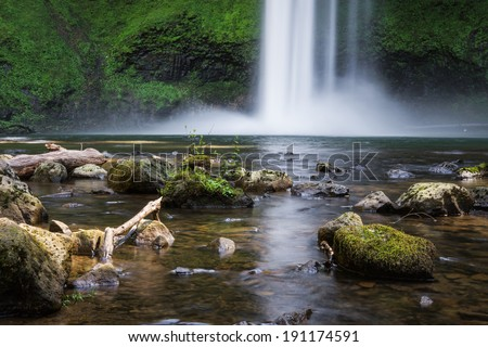 beautiful natural scene of silver lake falls in Oregon with a slow shutter speed for a silky look - stock photo