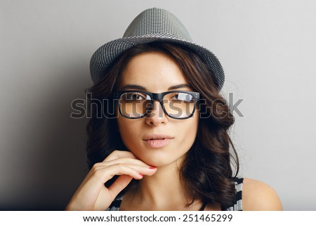 Beautiful, naturall girl in a hat and glasses. - stock photo