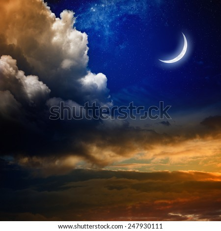 Beautiful nature background - new moon in dark blue sky with stars, glowing sunset clouds. Elements of this image furnished by NASA nasa.gov - stock photo