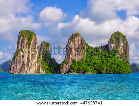 Beautiful nature landscape with sea and rocky island in Halong bay, Vietnam, Southeast Asia - stock photo