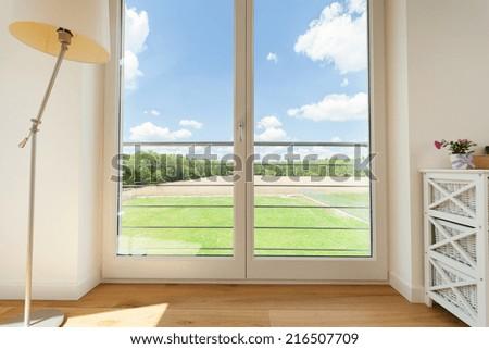 Beautiful nature view from big balcony windows - stock photo