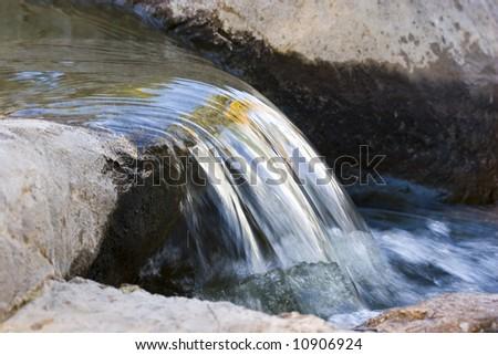 Beautiful nature waterfall on a small lake - stock photo