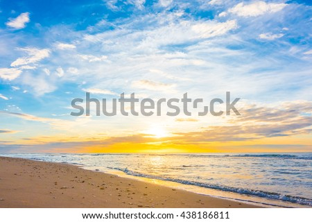 Beautiful nature with sunset on the beach and sea or ocean - Boost up color and Filter Processing - stock photo