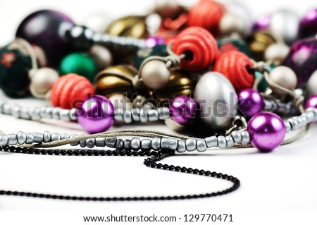Beautiful  necklace closeup on white background,shallow focus - stock photo