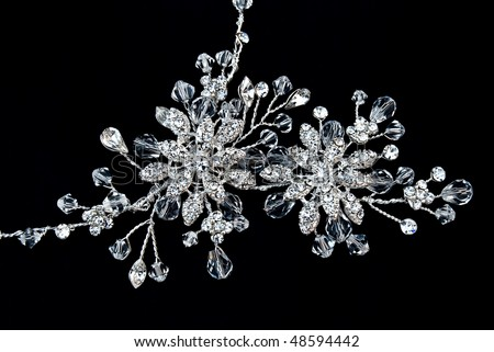 Beautiful necklace from crystals on a black background - stock photo