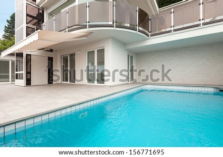 beautiful new apartment building with pool, view outdoor - stock photo