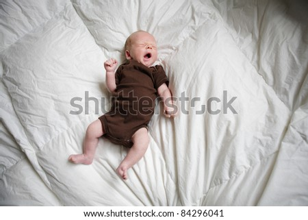 Beautiful new born baby sleeping in his bed. - stock photo