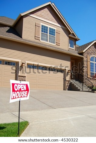 Beautiful New Home with Open House Sign - stock photo