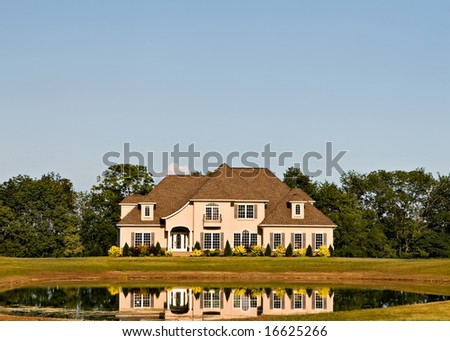 Beautiful New Home with reflecting pond - stock photo