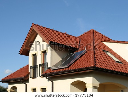 Beautiful new home with solar panels on the roof - environmental friendly! - stock photo