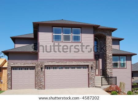 Beautiful New Home with Two-Car Garage - stock photo