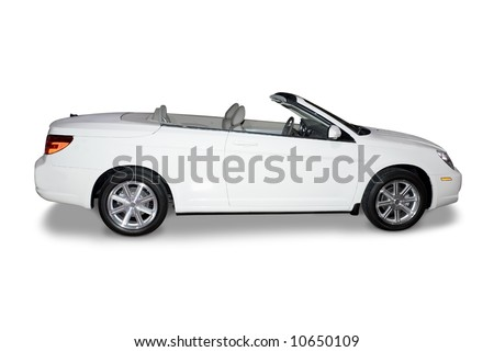 Beautiful new white convertible  car isolated on a white background. A realistic shadow is drawn in under the car for you. A clipping path for the car only minus the shadow is included. - stock photo