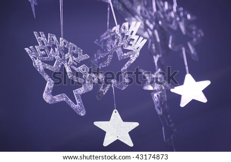 Beautiful New Year's ornaments in the form of stars on a dark blue background - stock photo