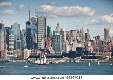 beautiful new york city skyline on a sunny day over hudson river