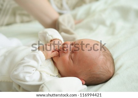 Beautiful newborn baby lying in his bed