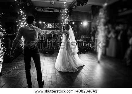 Beautiful Newlywed Couple First Dance At Wedding Reception Surrounded By Smoke And Lights Sparks Bw
