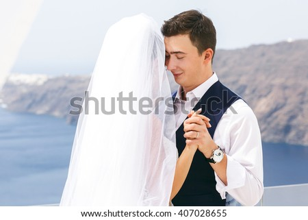 Beautiful newlyweds dancing on sea shore