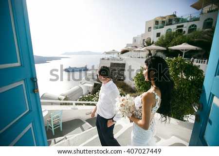 Beautiful newlyweds in hotel on sea shore